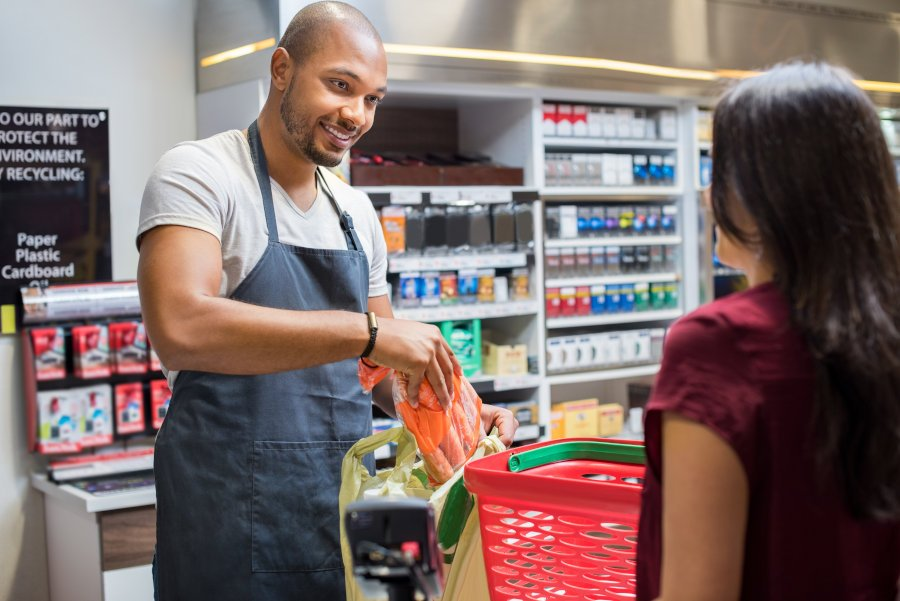 Cashier helping customer at point of sale